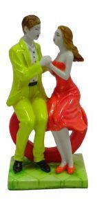 "Paras Magic Couple Sitting On Heart Yellow And Orange(4.5X3X9"")"