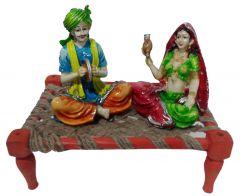 "Paras Magic Rajasthani Sitting on Charpai(11X7X9.5"")"