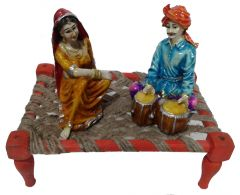 "Paras Magic Rajasthani Sitting on Charpai(11X7X9.5"") K1"