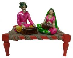 "Paras Magic Rajasthani Sitting on Charpai(11X7X9.5"") K6"